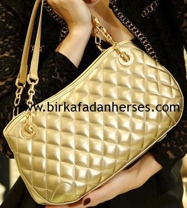 altın gold dore kol çantası